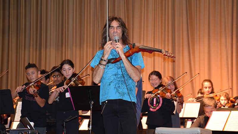 Orchestras Play Concert Alongside Famous Composer